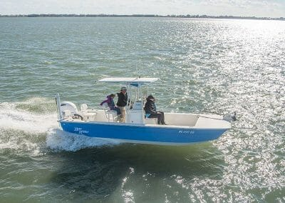 3 people on a blue FlatBottom2260 side view