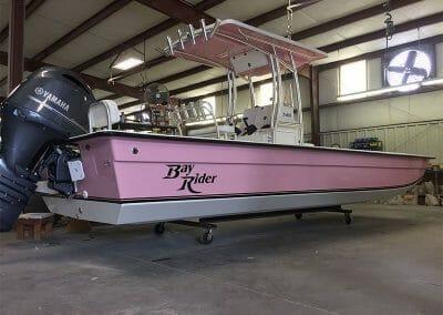 pink bayrider flatbottom in the garage