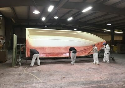 mean spray painting a boat