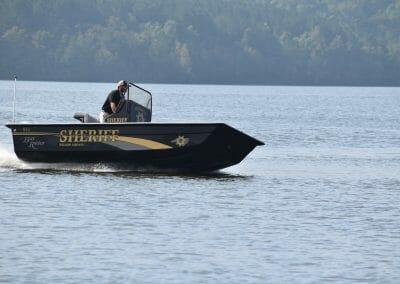 man cruising on a sheriff boat