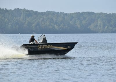 man steering a sheriff boat