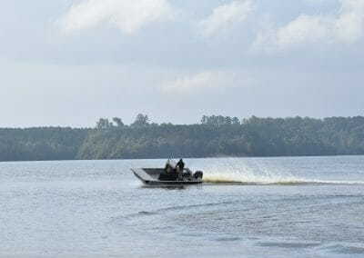 man turning a sheriff boat at a sharp angle