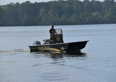 man driving a sheriff boat
