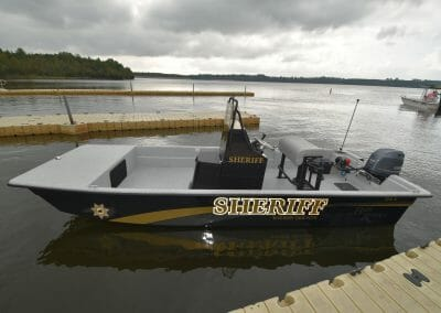 sheriff boat standing still side angle
