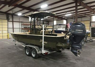 custom green law enforcement boat back side view