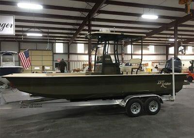 custom green law enforcement boat side view