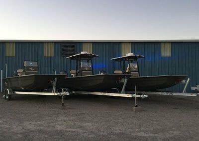 3 law enforcement boats side by side