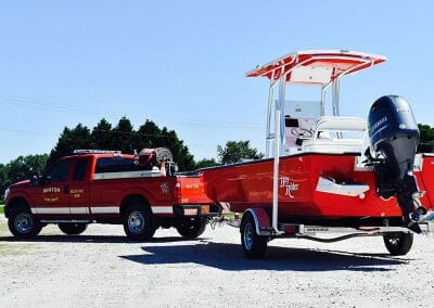 winton fire dept truck pulling a bright red bayrider