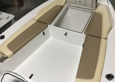 livewell/cooler and cushions on a boat
