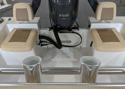 2 seats near the motor of a bayrider 2260fs